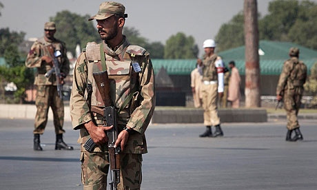 Soldiers prepare to raid the army headquarters in Rawalpindi.