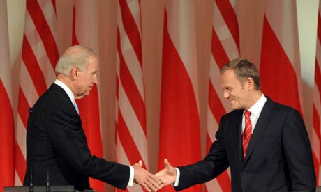 Joe Biden, the US vice-president, and Donald Tusk, Poland's prime minister, shake hands in Warsaw.
