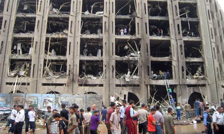 Windows are shattered at the offices of the justice ministry building after an explosion in Baghdad.