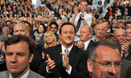Party leader David Cameron applauds George Osborne's speech