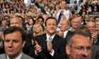 Party leader David Cameron applauds George Osborne's speech