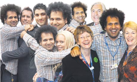 Sarfraz Mansoor hugs some Tories at conference.