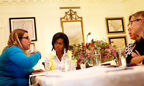 Michelle Obama meets with members of her staff at the White House.