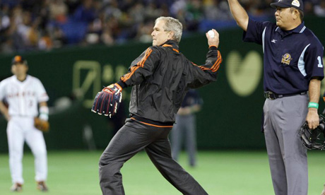 George Bush throws the ceremonial first pitch before game three of the Japan Series in Tokyo.