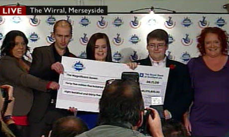 Euromillions lottery winners from a syndicate at a Liverpool BT call centre receive their cheque