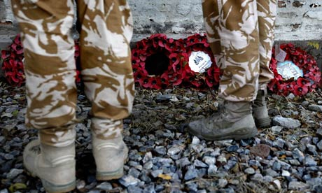 British soldiers attend a Remembrance Day ceremony at the British cemetery in Kabul