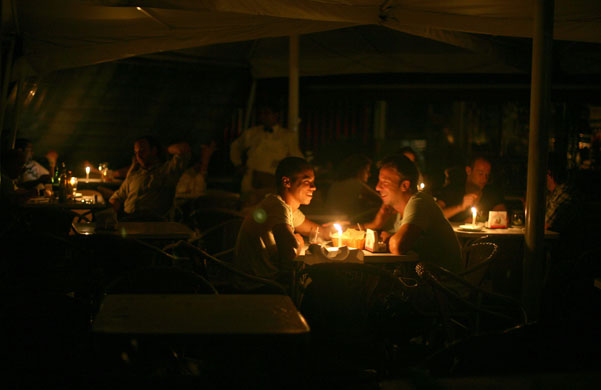 dining by candlelight in the Sao Paulo blackout. This is not us, but very much like us and in the same area!