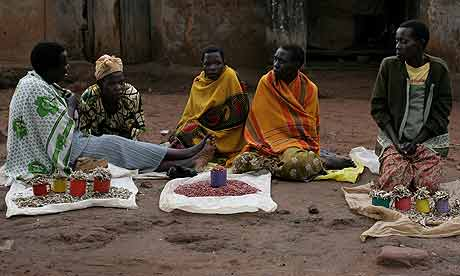 Women selling fish and groundnuts at Tiriri trading centre, Katine
