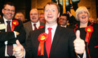 Labour candidate Willie Bain gives thumbs-up as he wins Glasgow North East byelection