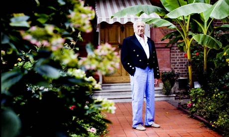 Michael Winner outside his London mansion.