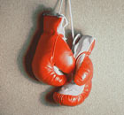 Pair of boxing gloves hanging on wall