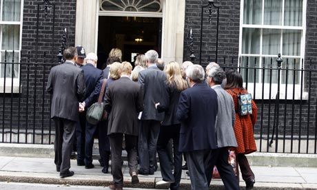 Journalists arrive for Gordon Brown's monthly press conference at 10 Downing Street in October 2007.