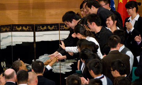 US President Barack Obama greets guests at the Museum of Science and Technology in Shanghai