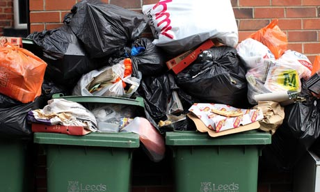 Overflowing refuse bins litter the streets in Leeds. Collectors voted to return to work this week.