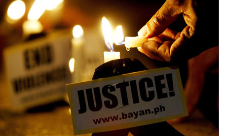 Protesters in Manila call for justice after the massacre  in the southern Philippines.