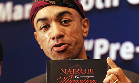 Barack Obama's half brother Mark Ndesandjo shows his novel at a press conference in Guangzhou.