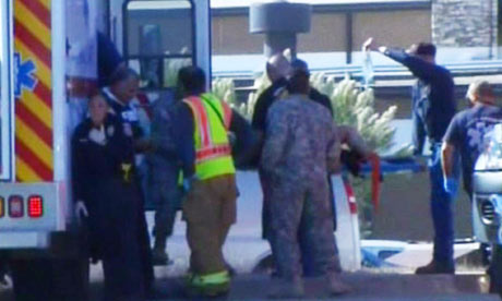 ... a injured person into an ambulance after shooting at Fort Hood, Texas.