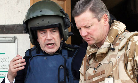 Gordon Brown wears a helmet and body armour as he leaves 'Little Heathrow' at Kandahar airbase