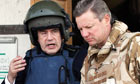 Gordon Brown wears a helmet and body armour as