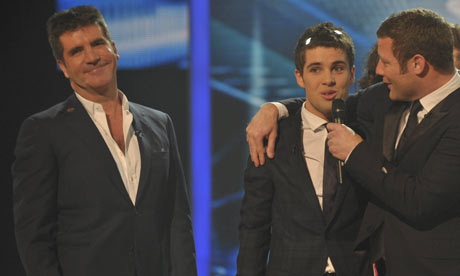 Simon Cowell (left) with Joe McElderry and Dermot O'Leary on The X-Factor on 13 December 2009.