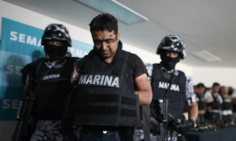 Mexican naval officers escort members of the Beltran Leyva drug cartel in Mexico City