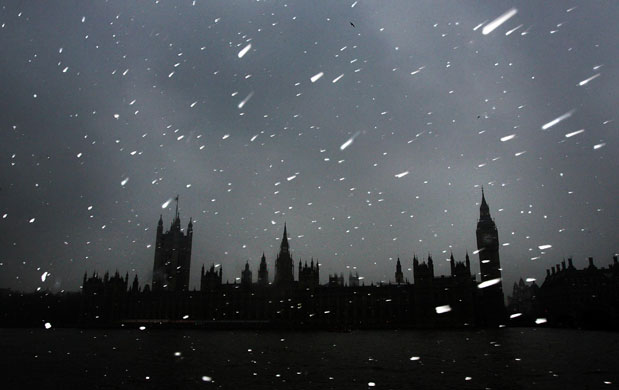24 hours in pictures: London, UK: Snow falls over the Houses of Parliament in Westminster