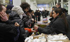Eurostar staff hand out hot drinks and sandwiches to passengers after train services were cancelled.