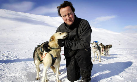 David Cameron with a husky called Troika on Svalbard, Norway