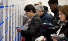 Job seekers at a Graduate Recruitment Fair in April