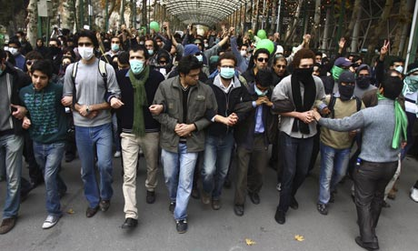 Pro-reform Iranian students march during a protest at the Tehran University campus in Iran.