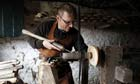 Robin Wood using a pole lathe to make a wooden bowl at his studio in Edale, Derbyshire.