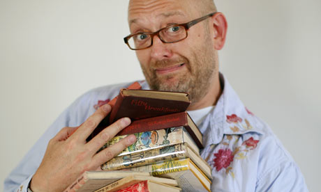 Tim Hayward holds a pile of old recipe books