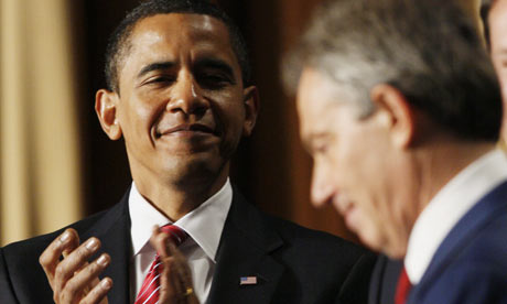 Barack Obama applauds Tony Blair at the US president's National Prayer Breakfast, 5 February 5 2009