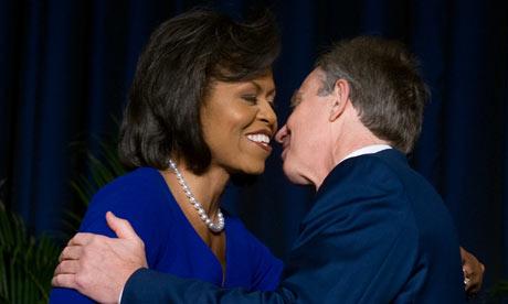 Tony Blair kisses Michelle Obama during Barack Obama's National Prayer Breakfast on 5 February 2009.