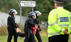 A protester is arrested at Kingsnorth power station