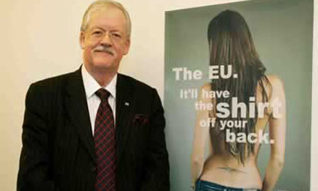 Roger Helmer poses with campaign poster