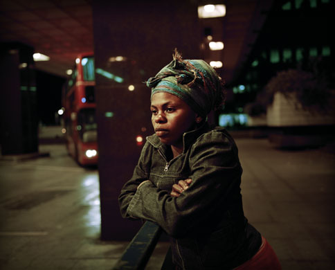 Asylum seekers: 20 year old Thania, from DR Congo, at London's Euston Station.