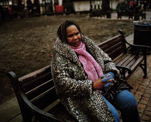 Asylum seekers: 62 year old Anie from Angola sits on a bench in London's Leicester Square.