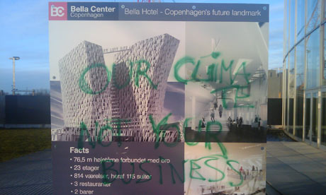 """Our climate, not your business"" - a graffitied sign at a carbon trading conference in March 2009"