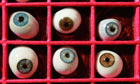 A drawer of antique glass eyes is displayed at the Science Museum's Object Store in London.