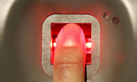A man has his fingerprint scanned on a new biometric check