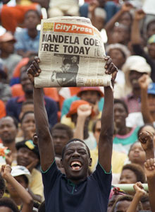 Sowetan holding newspaper announcing Nelson Mandela's release