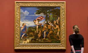A visitor to the National Gallery in London enjoys Titian's Bacchus and Ariadne