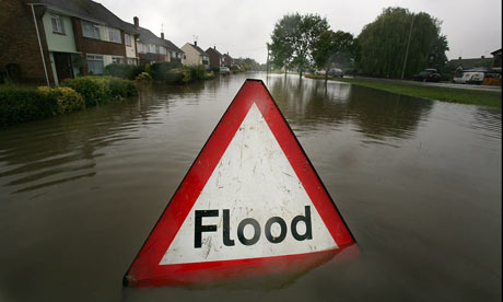 A-flood-sign-warns-of-flo-001.jpg