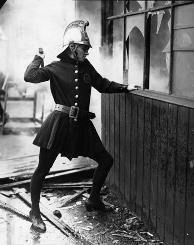 Firefighter uniforms: 1926: A member of the Achille Serre Ladies Fire Brigade in London