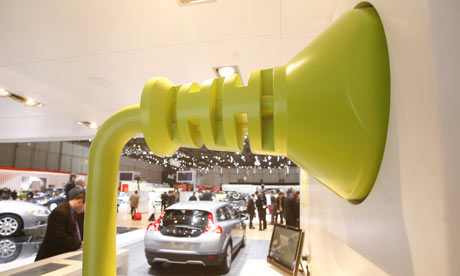 A giant electric car plug at the Volvo stand during  the 79th Geneva Car Show in Geneva