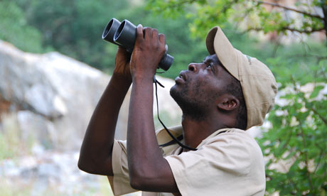 Michael, Stephen Moss's bird guide in Africa, watches for birds in Mpumalanga region of South Africa