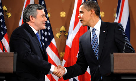 Barack Obama and Gordon Brown shake hands at a press conference