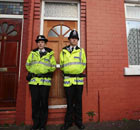 Police outside a house in Galsworthy Avenue, Cheetham Hill in Manchester
