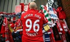 Liverpool fans pay their respects at the Hillsborough memorial at Anfield